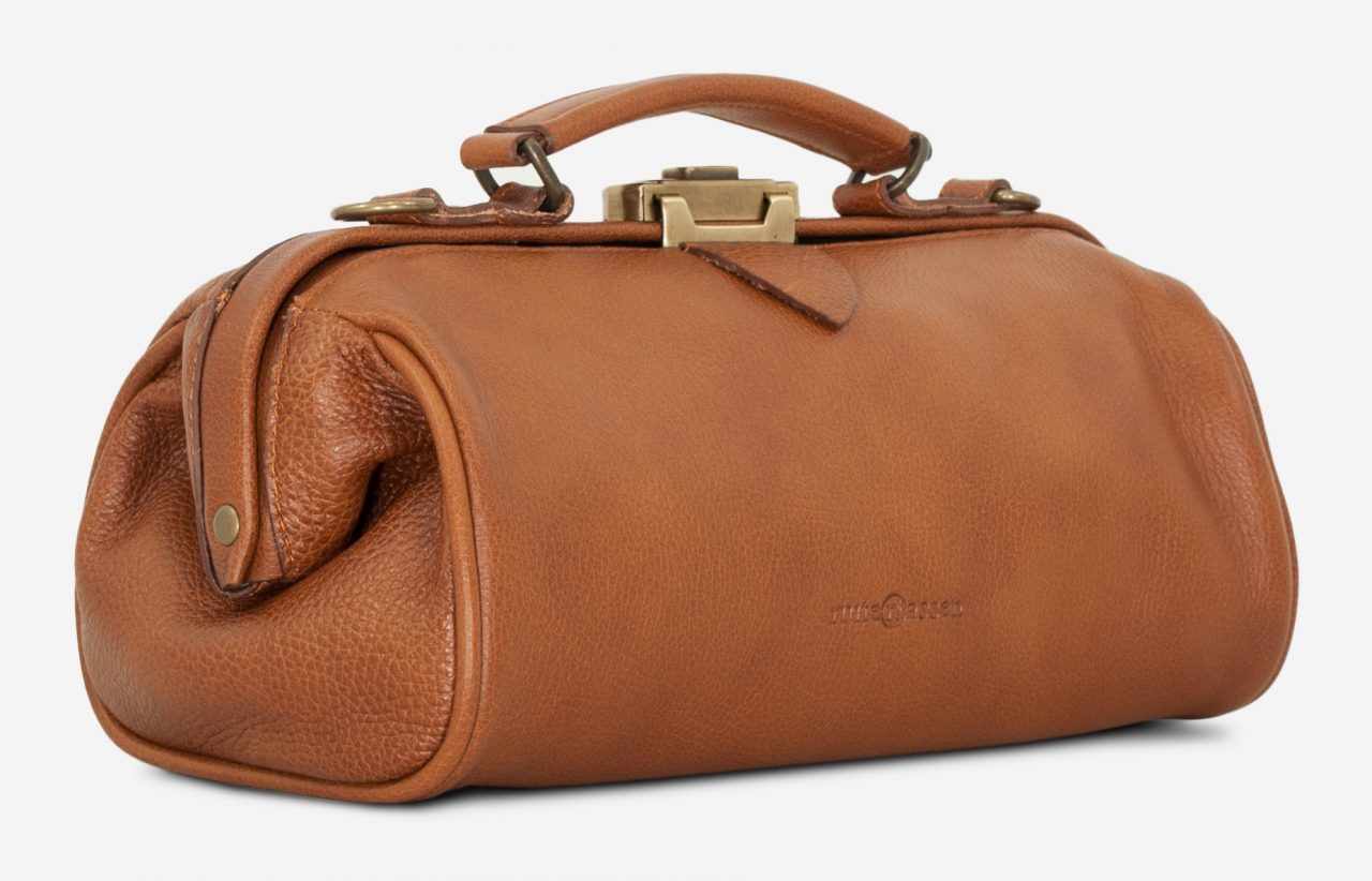 Side view of the soft brown leather doctor bag for women.