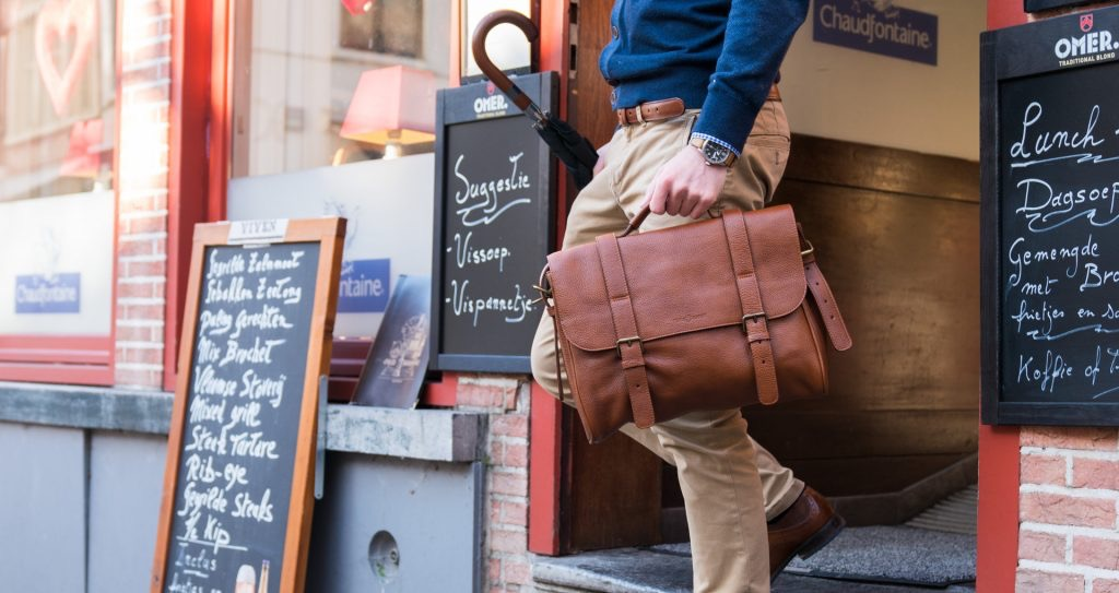 Man wearing the soft brown leather briefcase bag.