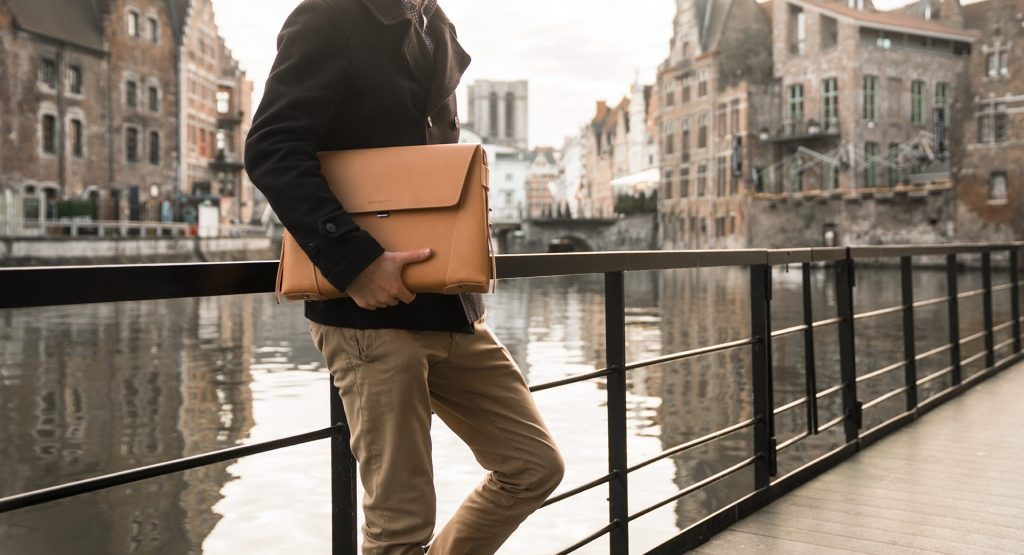 Man holding his vegetable tanned leather slim briefcase bag - 102176.