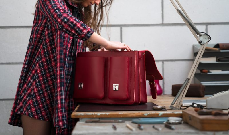 Student looking into her red leather satchel briefcase bag with 2 gussets and asymmetric front pockets - 152137.