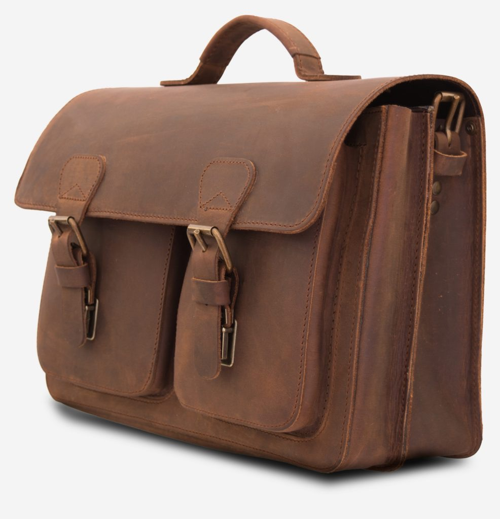 Side view of brown leather professor satchel with 2 compartments and 2 front pockets.