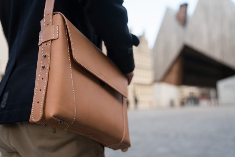 Man carrying his vegetable tanned leather slim briefcase bag on the shoulder - 102176.