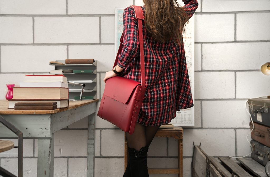 Women wearing the slim red vegetable-tanned leather briefcase bag.