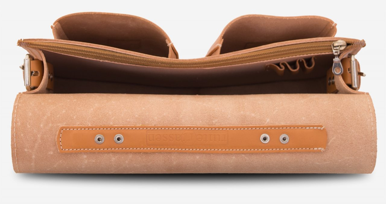 Inside view of the tan leather satchel briefcase with one main compartment and two front pockets.