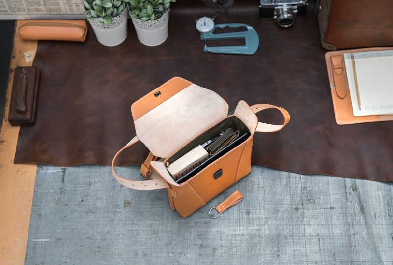 Top view of the small vegetable tanned leather crossbody bag.