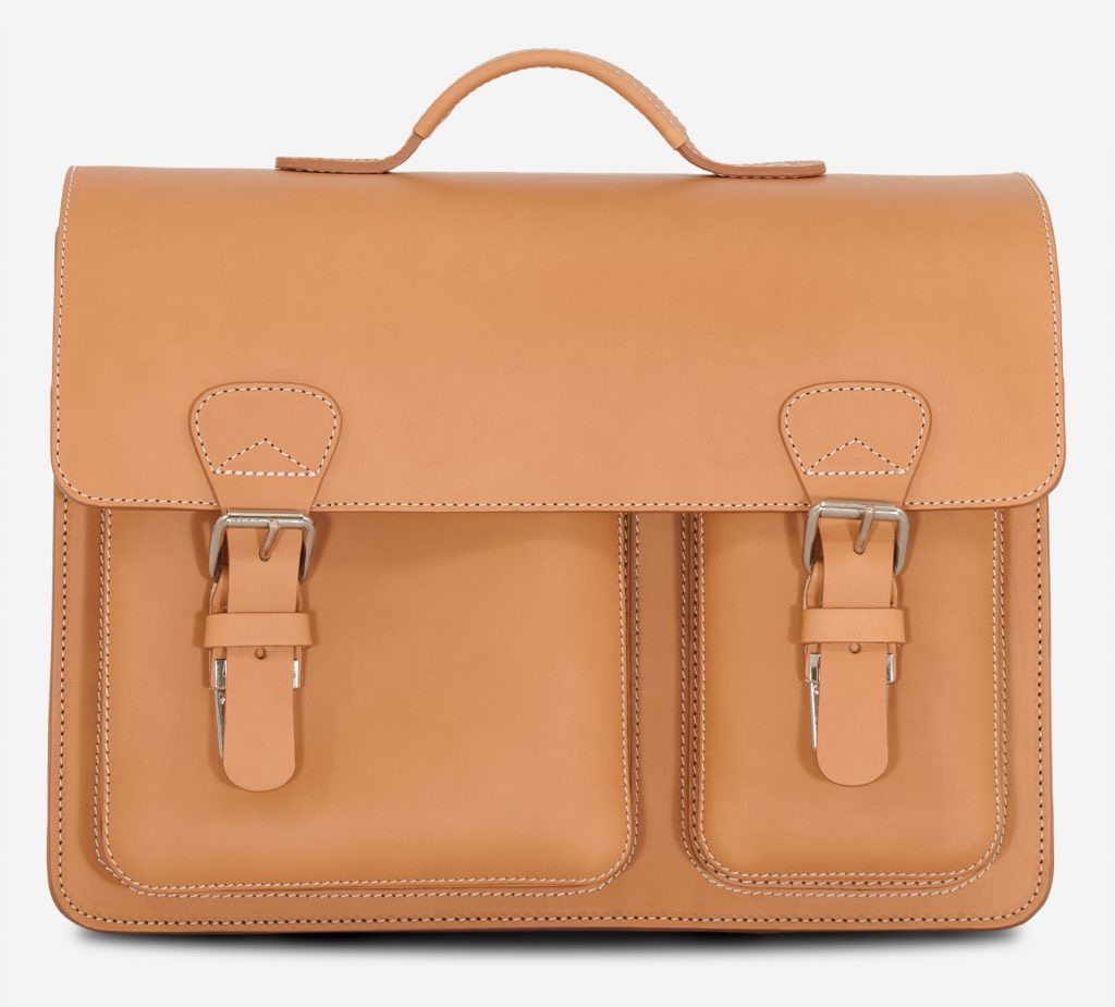 Front view of tan leather satchel briefcase with asymmetric front pockets.