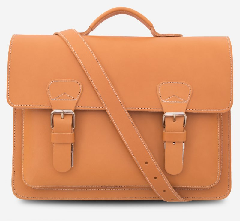 Front view of the tan leather briefcase with shoulder strap.