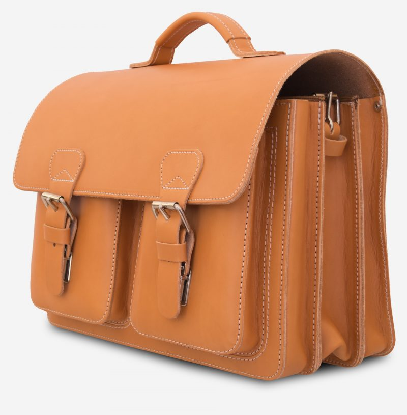 Side view of the professor tan leather satchel with 3 compartments and 2 symmetric front pockets.