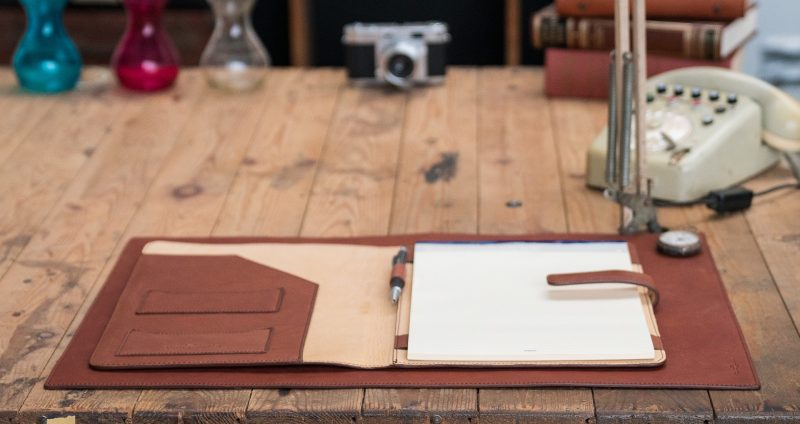 Luxury vegetable tanned leather A4 folio opened.