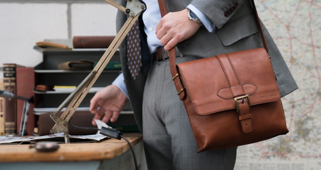 Man wearing the luxury soft vegetable-tanned brown leather crossbody bag.