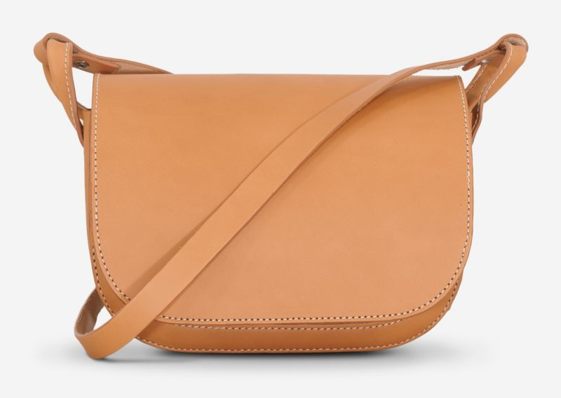 Front view of the vegetable tanned leather shoulder bag for women with 2 compartments.