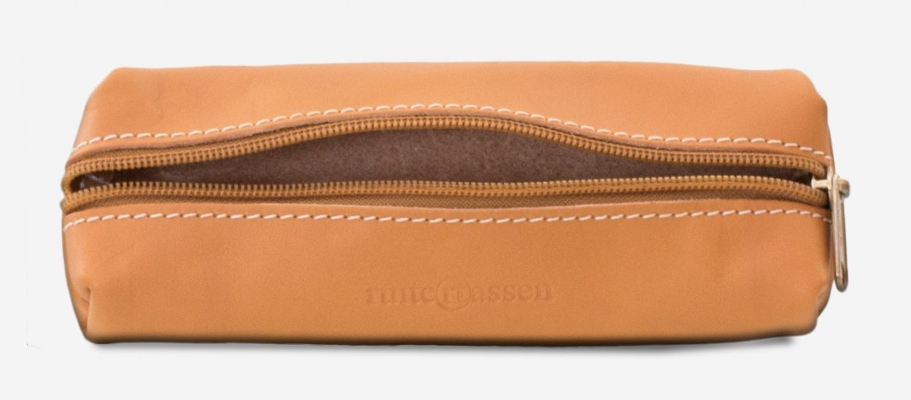 Inside view of the tan leather pencil case.
