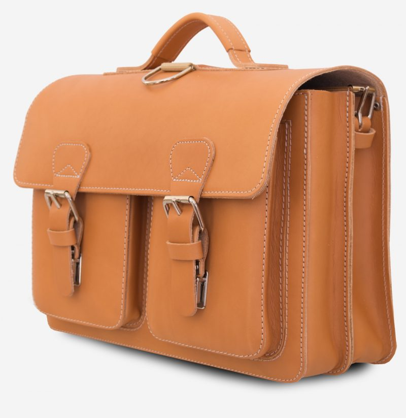 Side view of tan leather backpack satchel with 2 compartments and 2 front pockets.