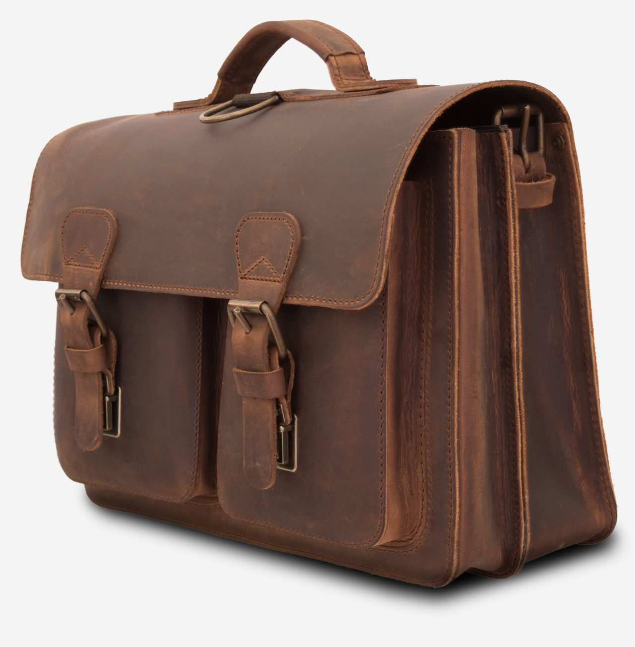 Side view of brown leather backpack satchel with 2 compartments and 2 front pockets.