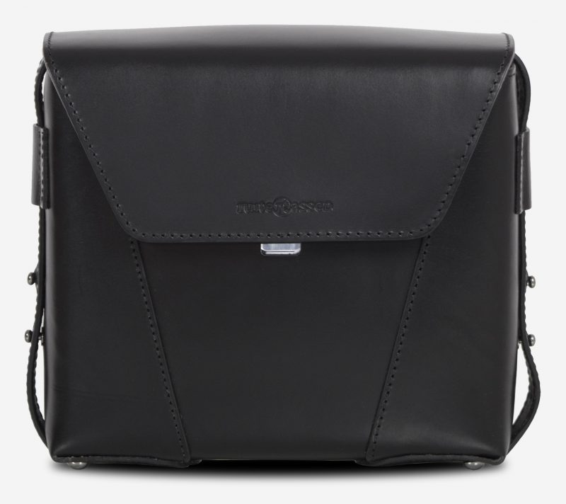Front view of the small black vegetable-tanned leather crossbody bag.