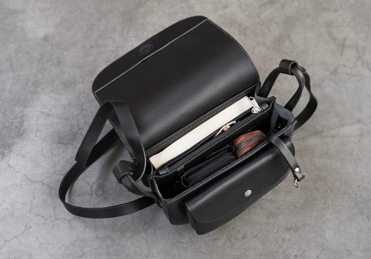 Top view of the 2 compartments black leather shoulder bag for women.