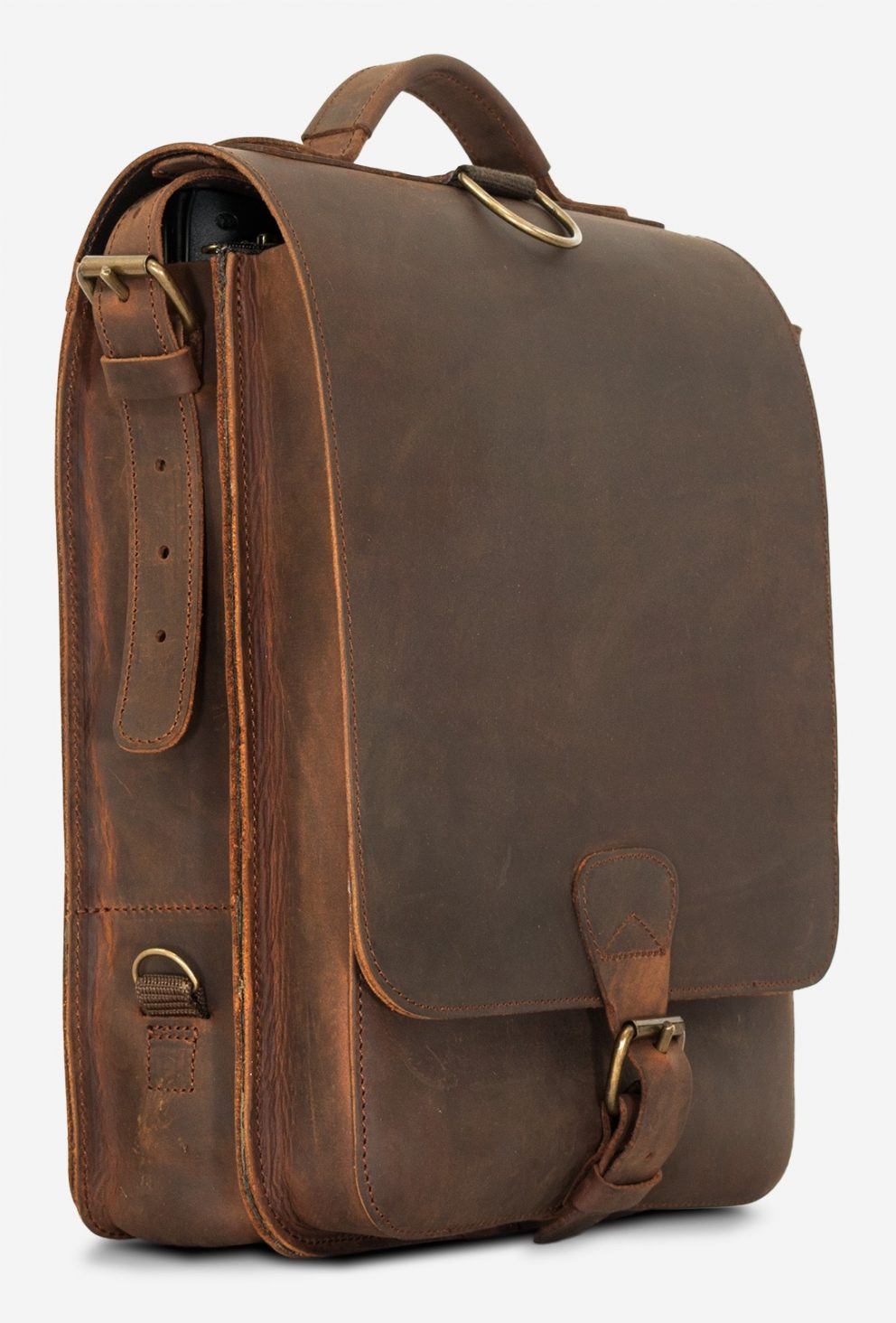 Side view of the vegetable-tanned brown leather backpack with shoulder belt.