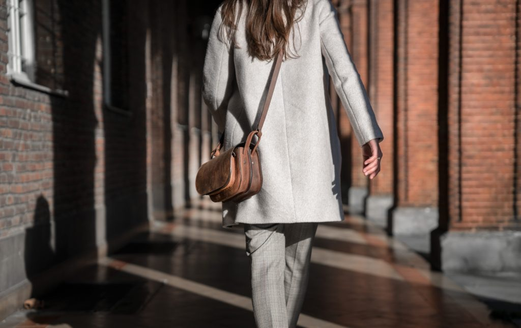 Woman wearing the handmade brown leather shoulder bag.