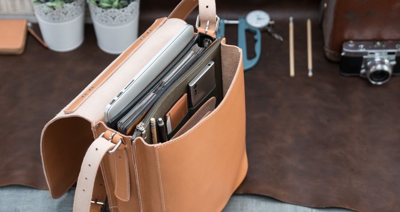 Top view of the vegetable tanned leather backpack with laptop computer.