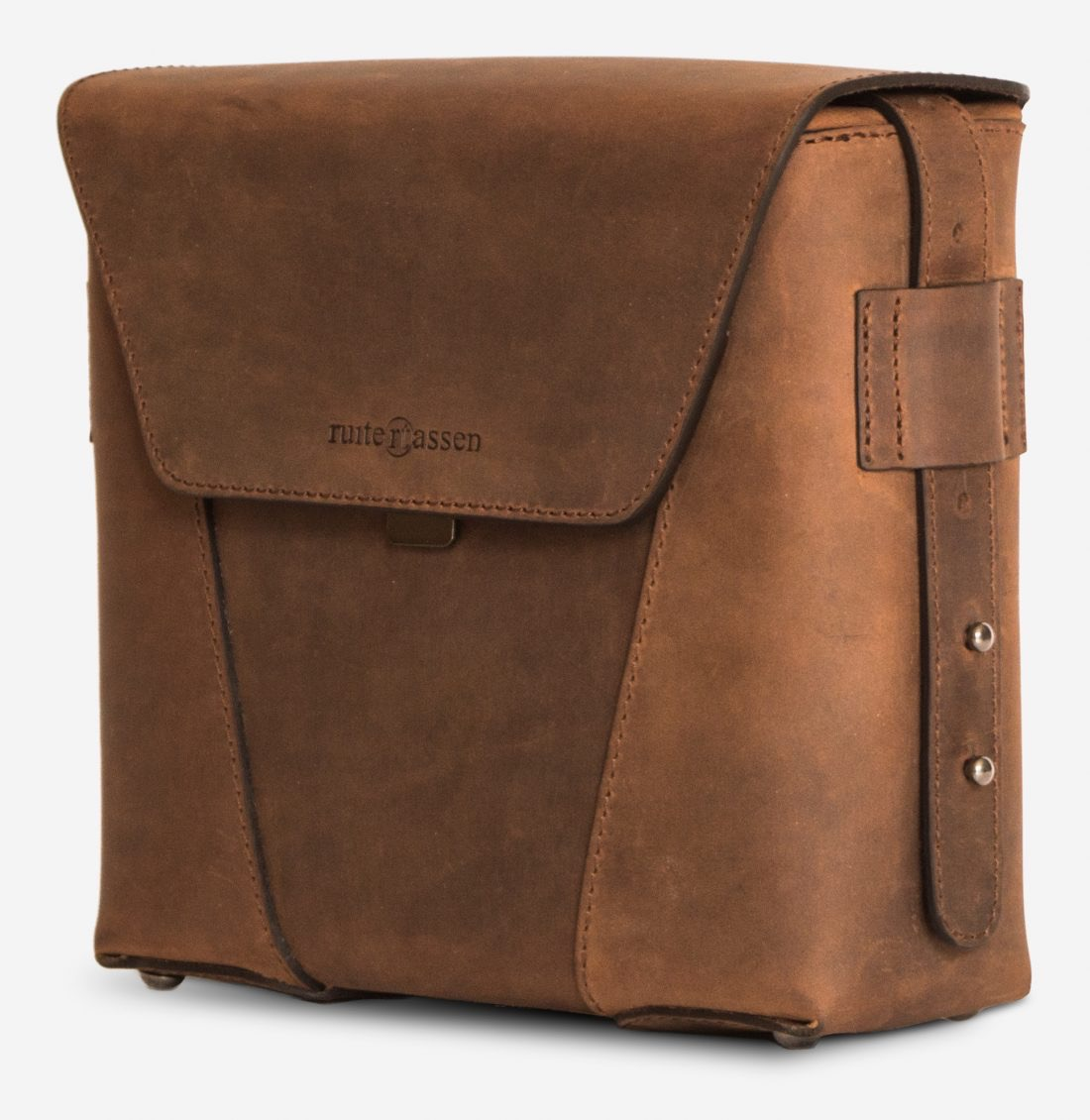 Side view of the small vegetable-tanned brown leather crossbody bag for men.