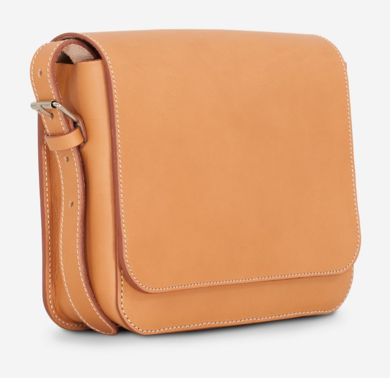 Side view of the small vegetable tanned leather crossbody bag for women.