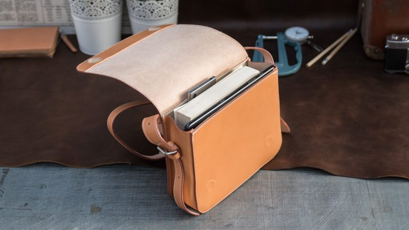 Top view of the small vegetable tanned leather crossbody bag for women.