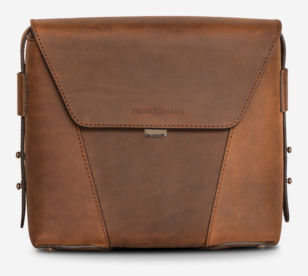 Front view of the small vegetable-tanned brown leather crossbody bag for men.