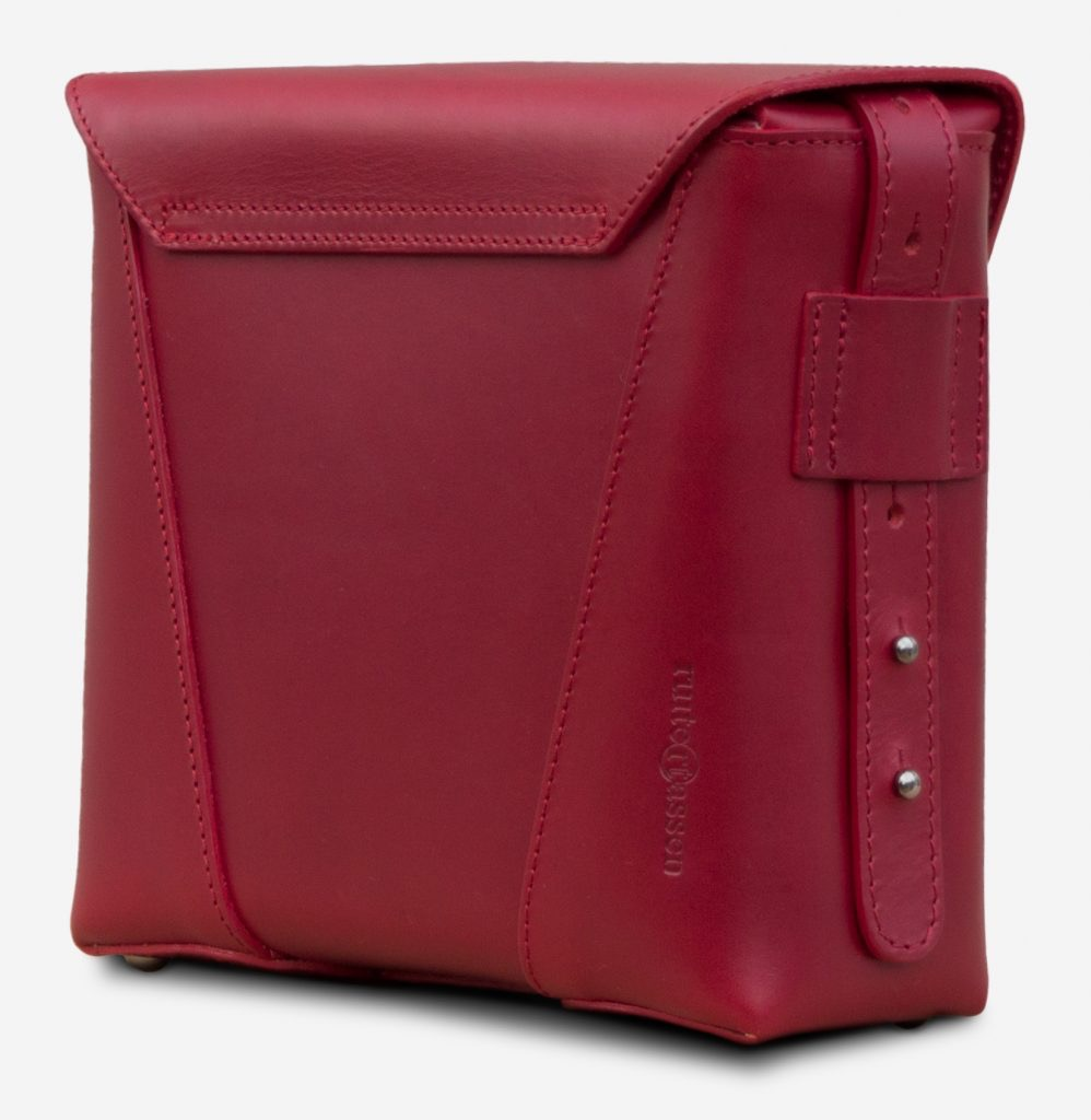 Back view of the small red vegetable-tanned leather crossbody bag for women.