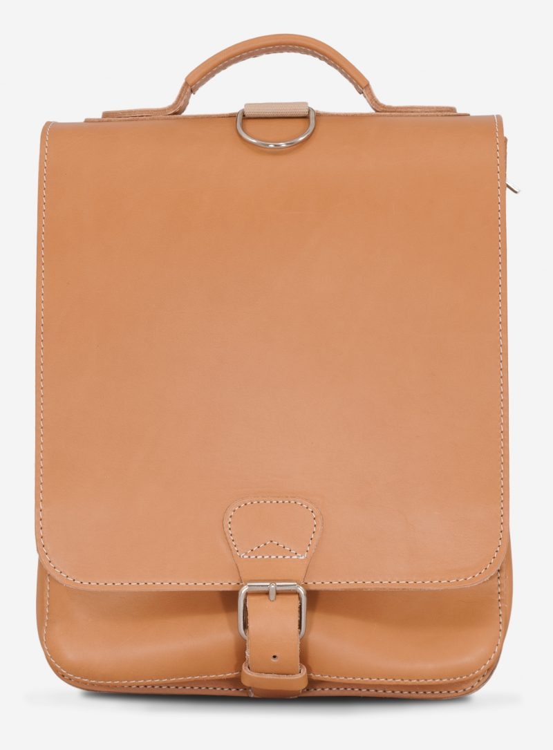 Front view of the vegetable tanned leather backpack with shoulder belt.