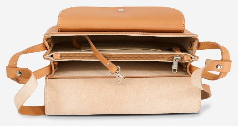 Inside the vegetable tanned leather shoulder bag for women with 2 compartments.
