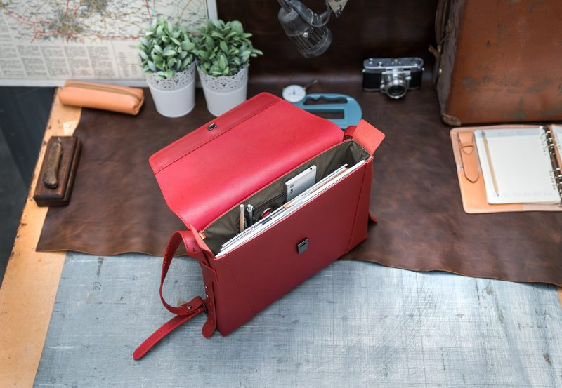 Top view of the slim red vegetable-tanned leather briefcase bag for women.