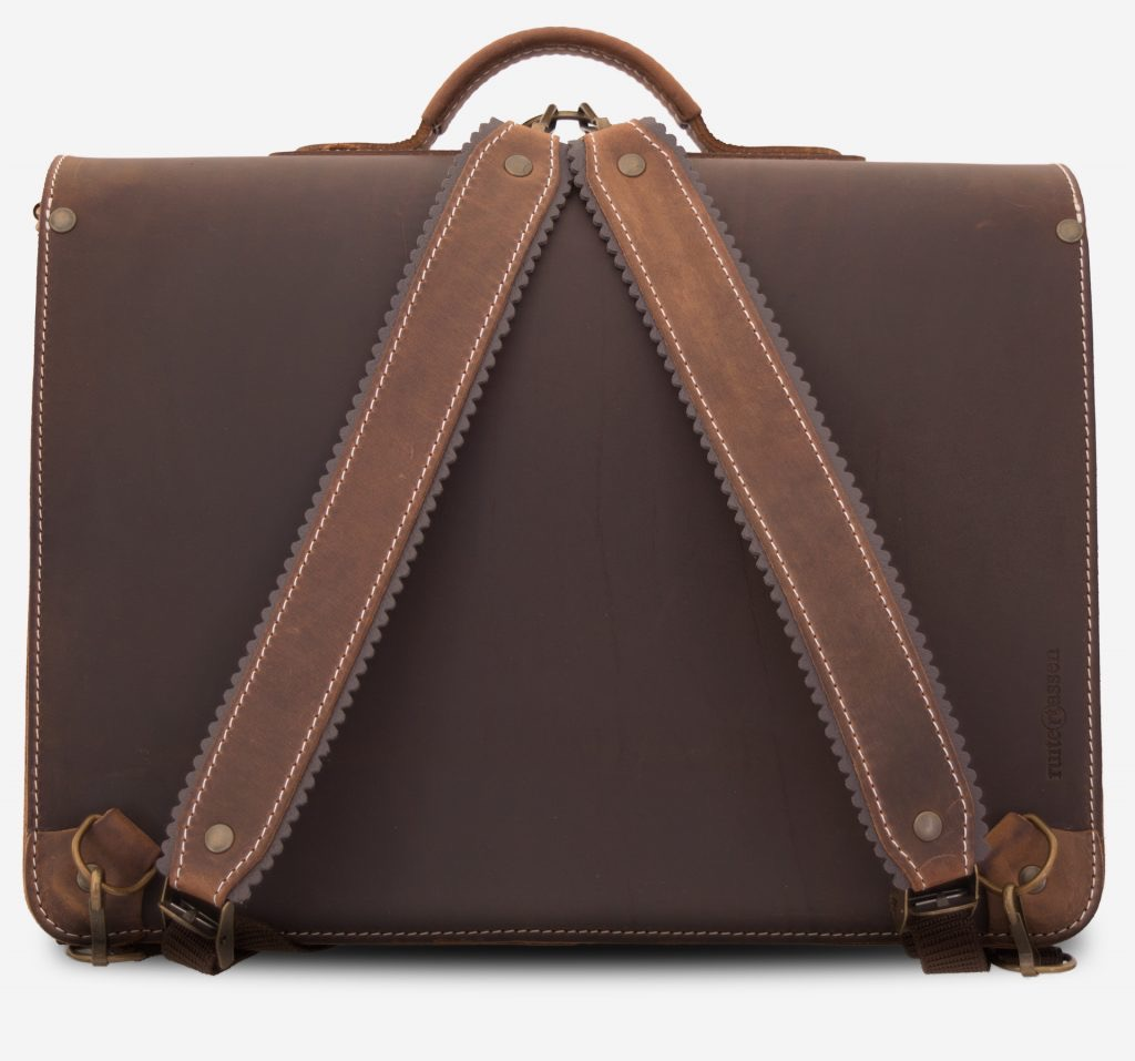 Back view of brown leather satchel backpack fitted with shoulder straps.