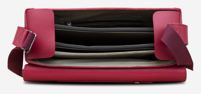 Inside view of the large red vegetable-tanned leather briefcase bag with laptop pocket for women.