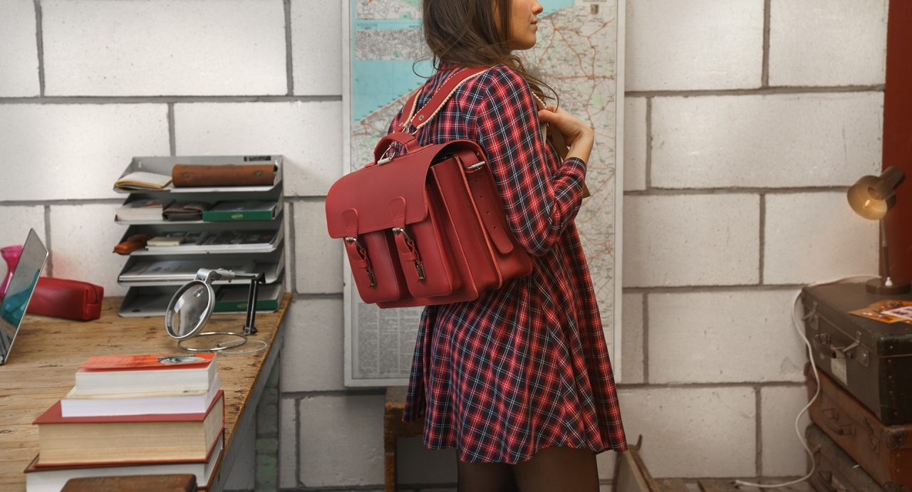 Student carrying her red leather satchel backpack with 2 gussets and symmetric front pockets for women - 152233.