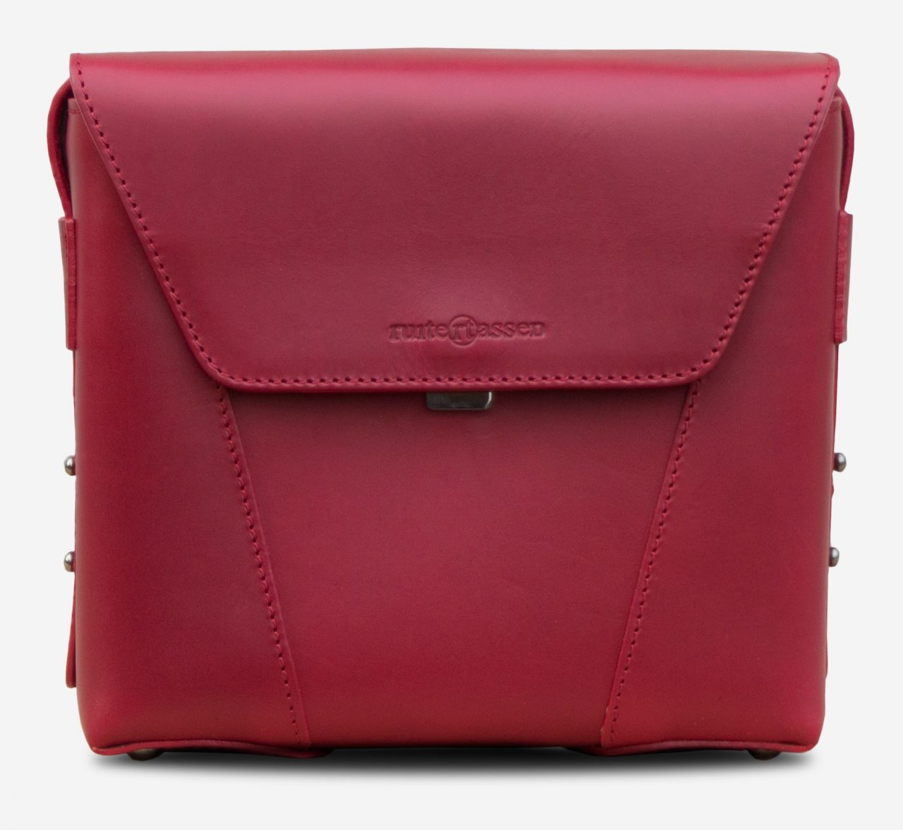 Front view of the small red vegetable-tanned leather crossbody bag for women.