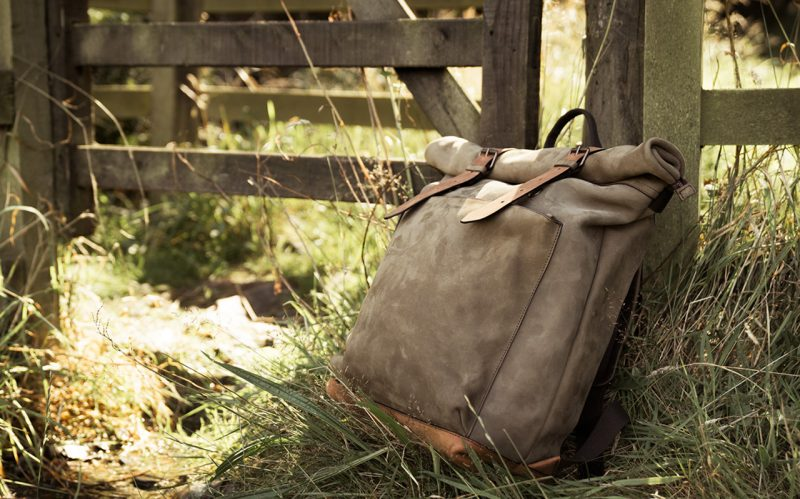 Large leather backpack in forest.
