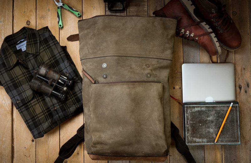 Large supple leather backpack with roll top opening.