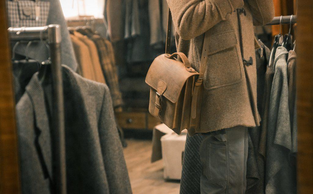 Man wearing a brown leather shoulder bag.