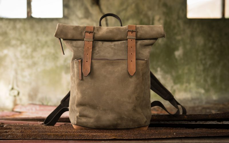 Roll top leather backpack in factory.