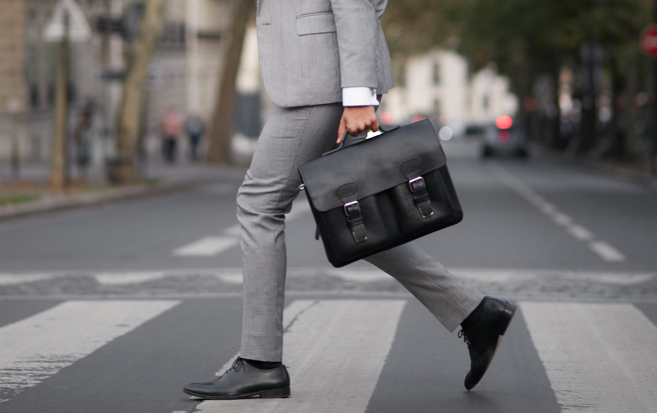 Businessman with vegetable tanned old school leather black satchel briefcase.