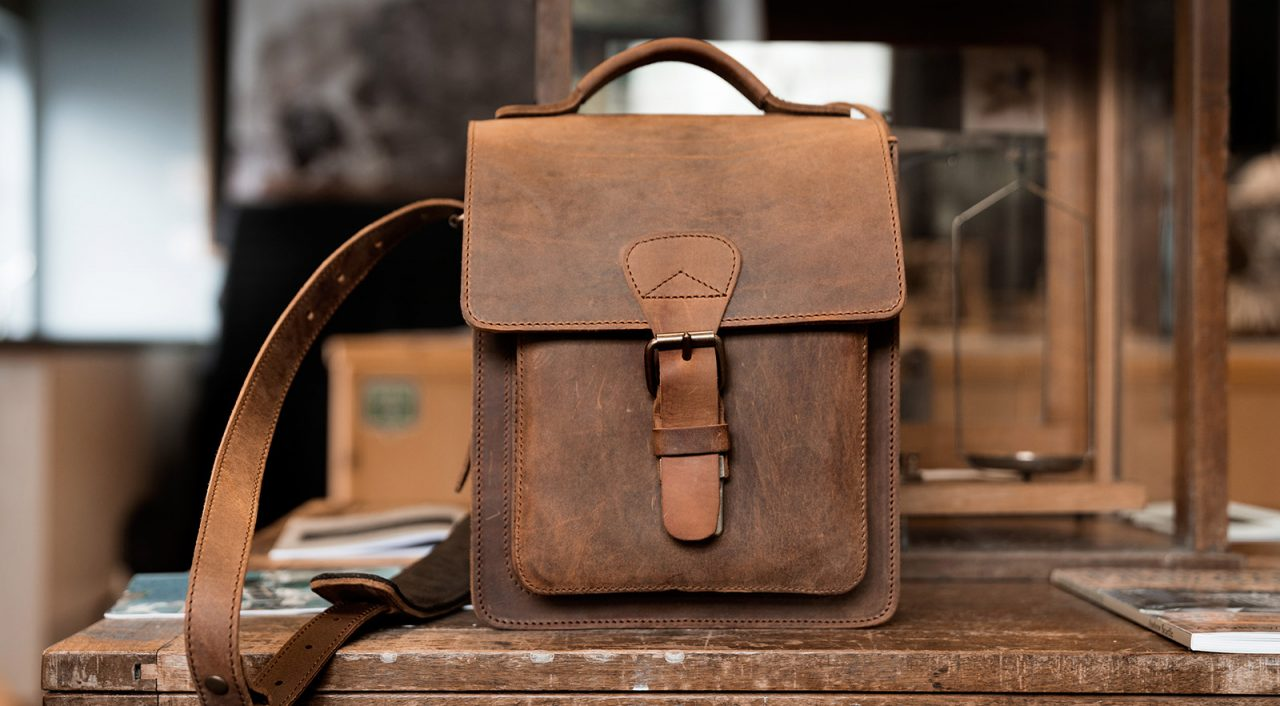 Vegetable-tanned brown leather shoulder bag.