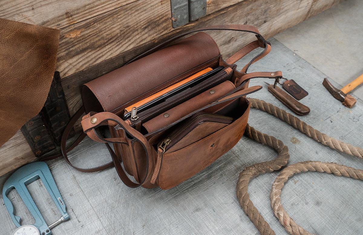 Beautiful brown leather saddlebag opened.