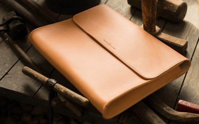 Tan leather document folder in workshop.