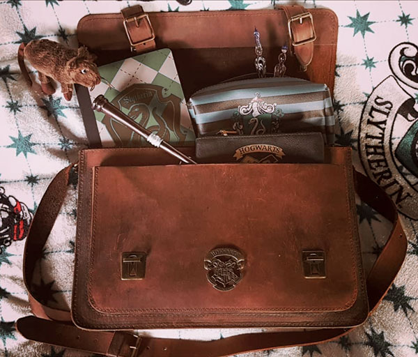 Harry Potter leather satchel with Harry Potter collector items.