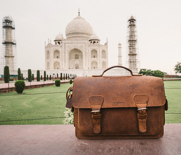 Leather camera bag in front of the Taj Mahal.