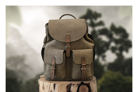 Soft leather backpack in forest.