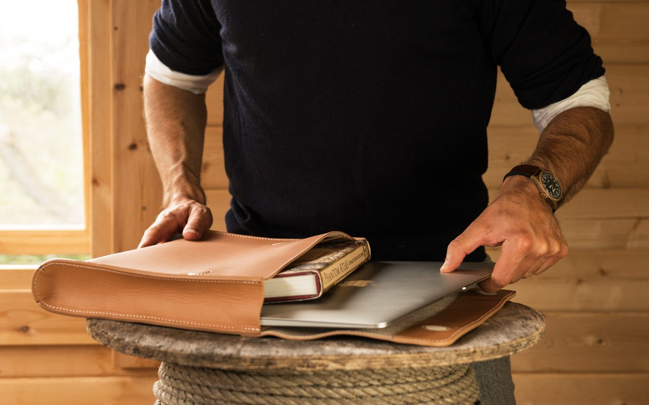 Man using a leather document folder.