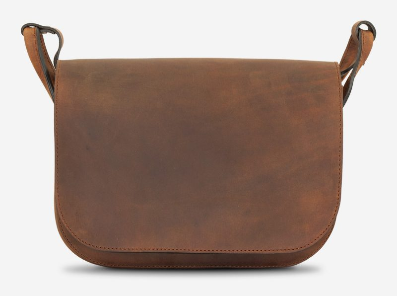 Front view of brown leather saddlebag for women.