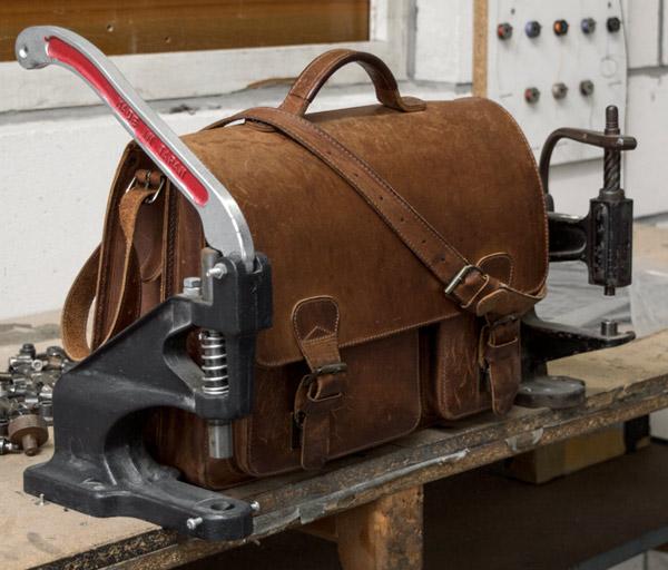 Vintage brown leather satchel in a workshop.