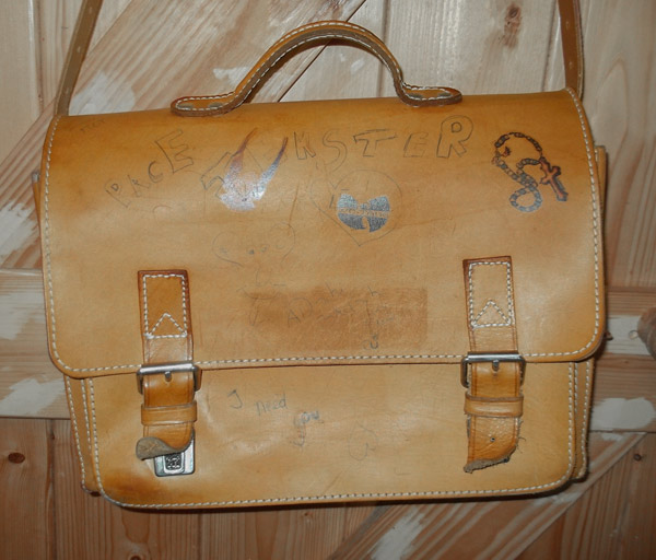 School leather satchel with drawings.